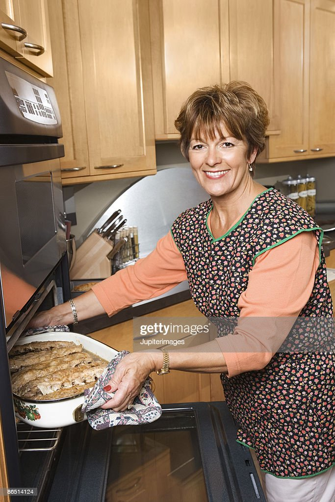 Woman baking in kitchen : Stock Photo