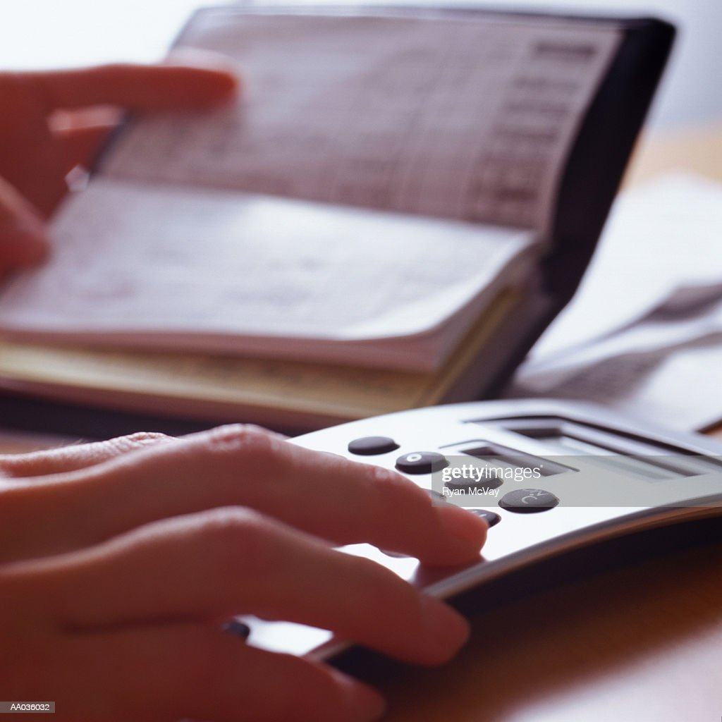 Woman Balancing Checkbook : Stock Photo