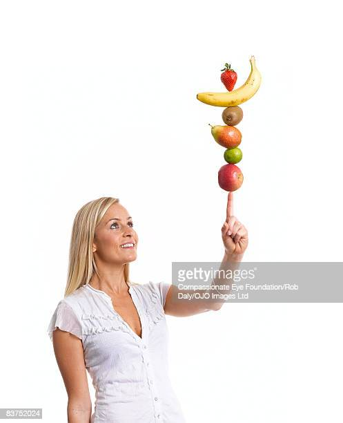 Woman Balancing Fruit