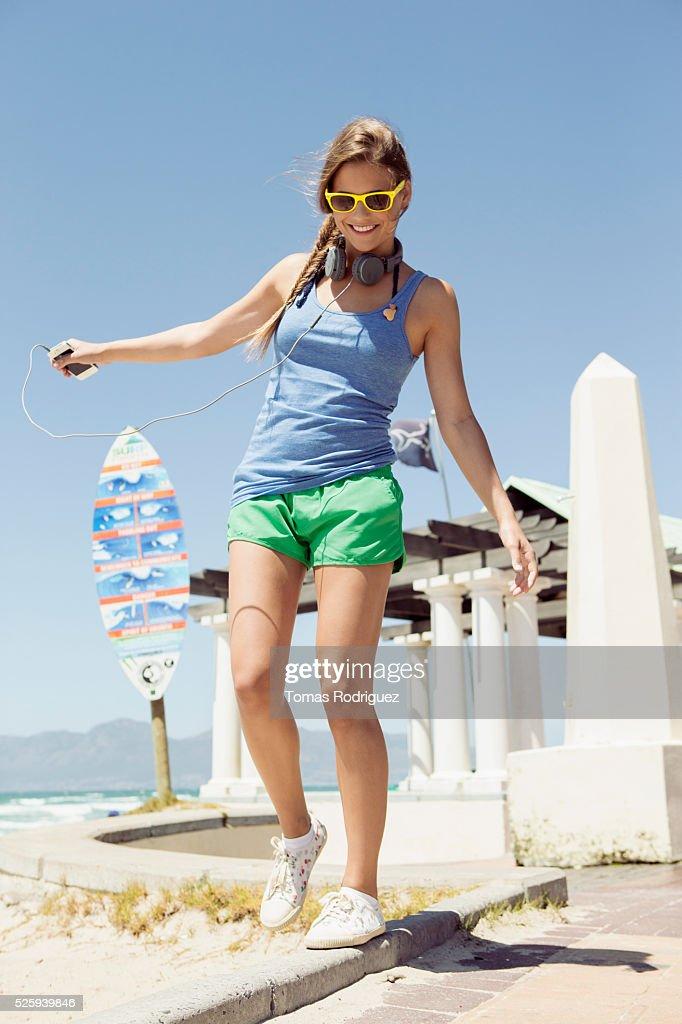 Woman balancing on curb : Bildbanksbilder