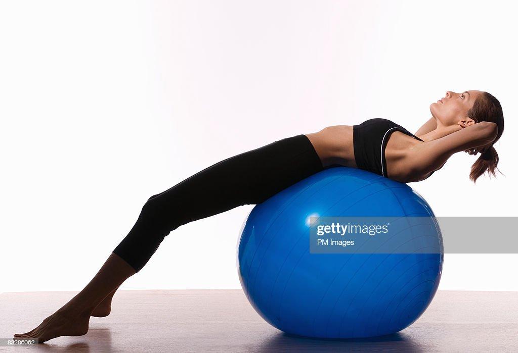 Woman balancing on exercise ball : Stock Photo