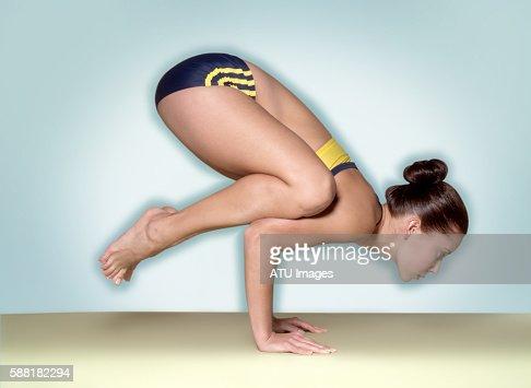 Woman Balancing on Hands : Stock Photo