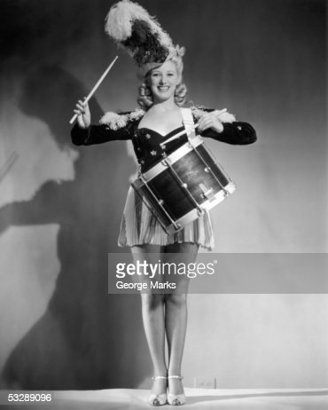 Woman banging on drum : Stock Photo