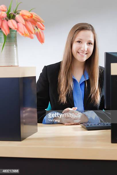 Woman Bank Teller at Counter Window Providing Financial Customer Service