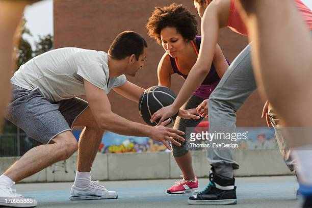 Woman Basketball Player Dribbling Ball