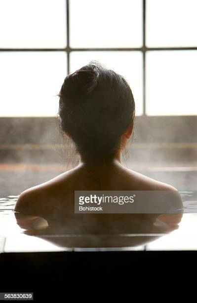 Woman bathing at hot spring resort