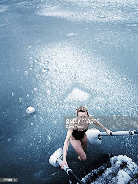 Woman bathing in icy sea.