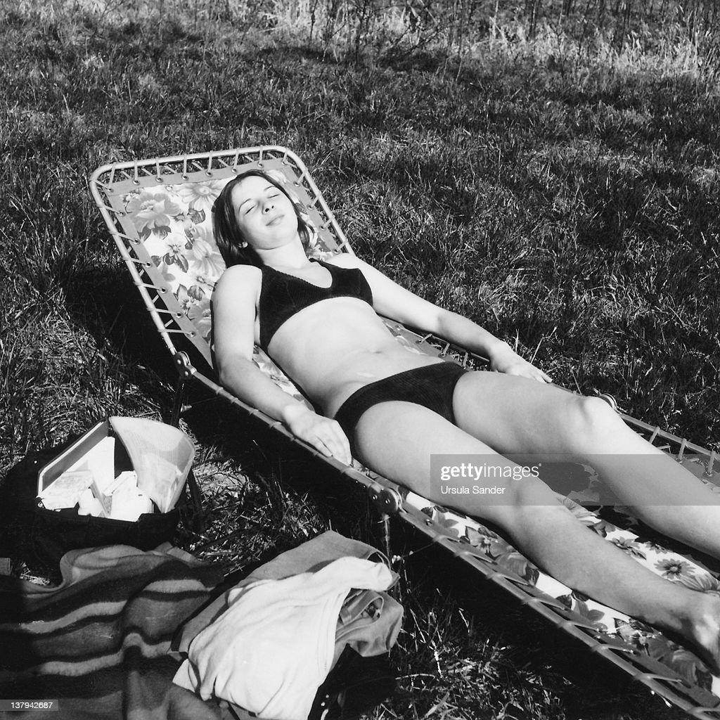 Woman bathing in sun : Stock Photo