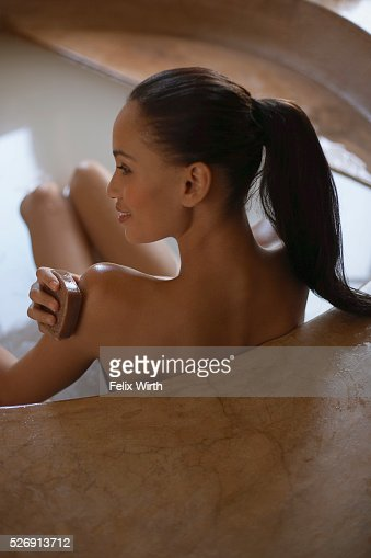 Woman bathing : Stock Photo