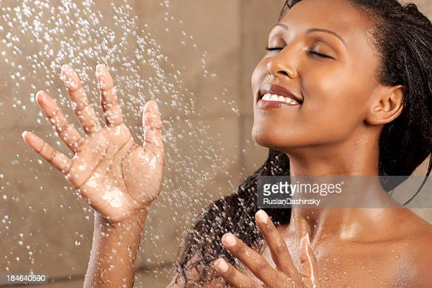 Woman bathing under the  shower.