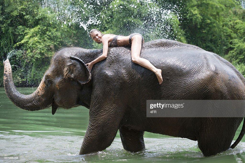 Woman bathing with an Elephant, Tropical Rain Forest