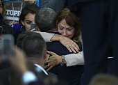 A woman becomes emotional as she hugs US President Barack Obama during an event at the University of Nebraska Omaha Baxter Arena on January 13 2016...