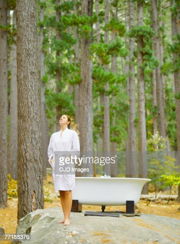 A woman before bathing outdoors in the woods : Stock Photo