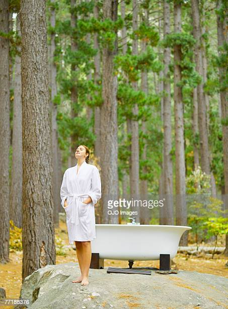 A woman before bathing outdoors in the woods