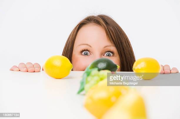 Woman behind a row of fruits