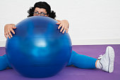 Woman Behind Exercise Ball