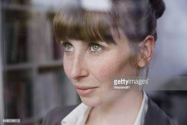 Woman behind glass pane