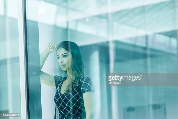 Woman behind glass window