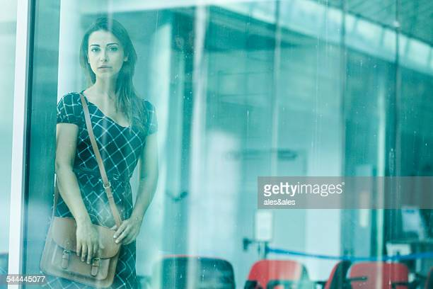 Woman behind glass window