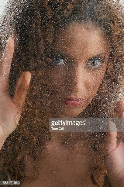 Woman Behind Steamy Glass
