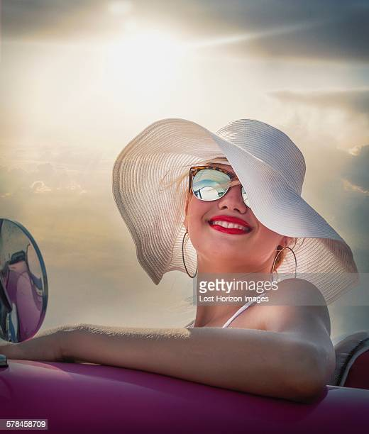 Woman behind wheel of Convertible
