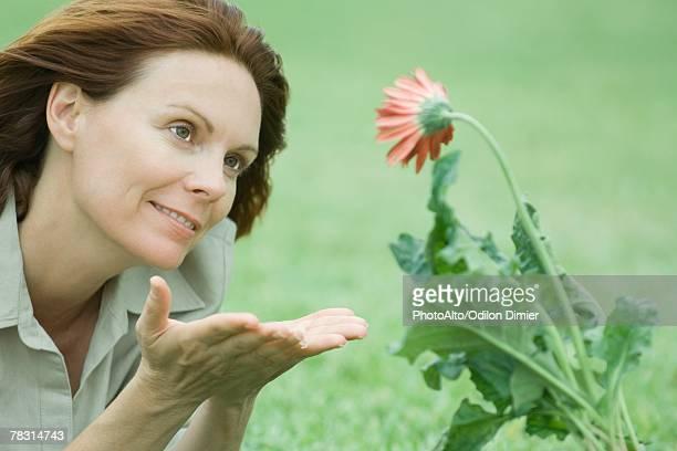 Woman beholding flower