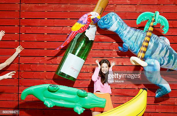 woman being bombarded by inflatables