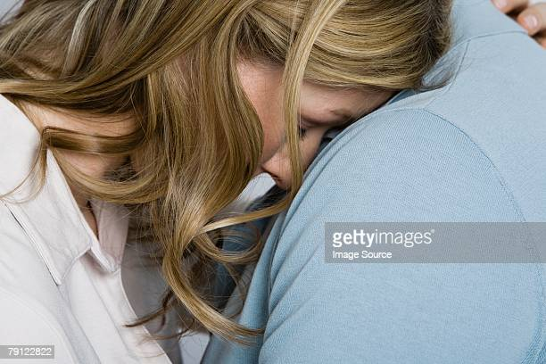 Woman being consoled