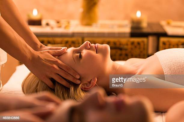 Woman being given a head massage in spa