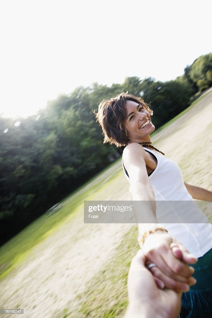 Woman Being Held by the Hand : Stock Photo