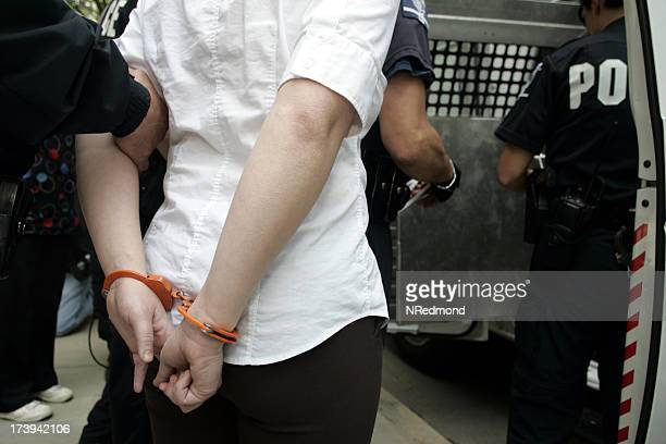 A woman being placed under arrest