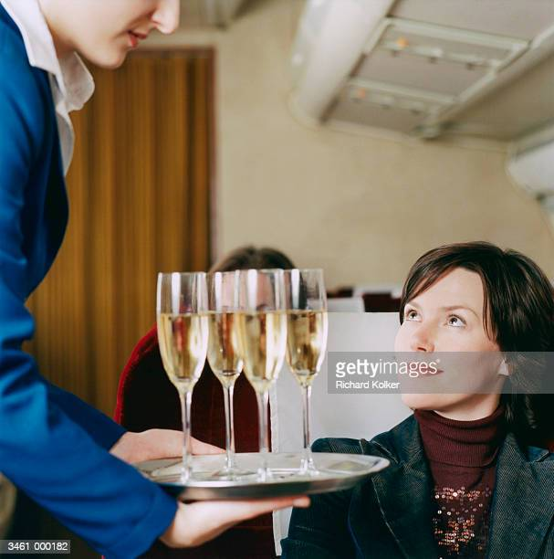 Woman Being Served Champagne