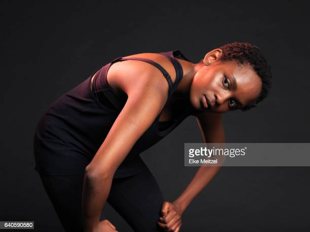 woman bending over catching ones breath