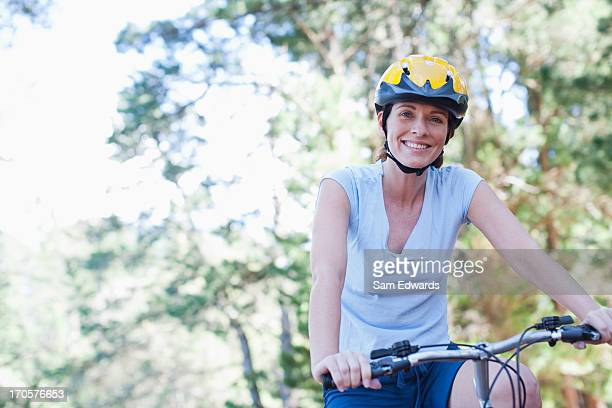 Woman bicycle riding in forest