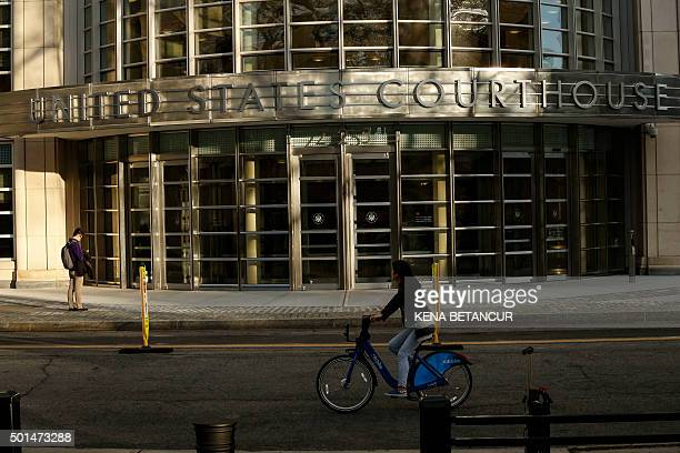 A woman bikes by the Federal District Court in Brooklyn where Former Honduras President Rafael Callejas made a US court appearance on December 15...