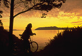 Woman Biking at Doe Bay