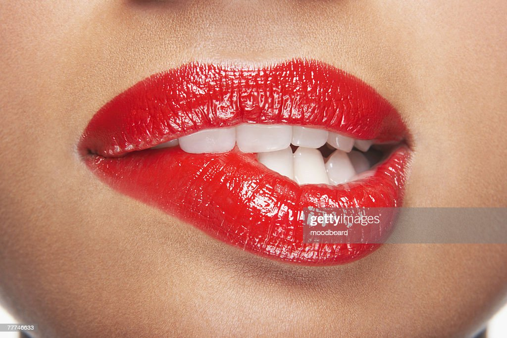 Woman Biting Lip : Stock Photo