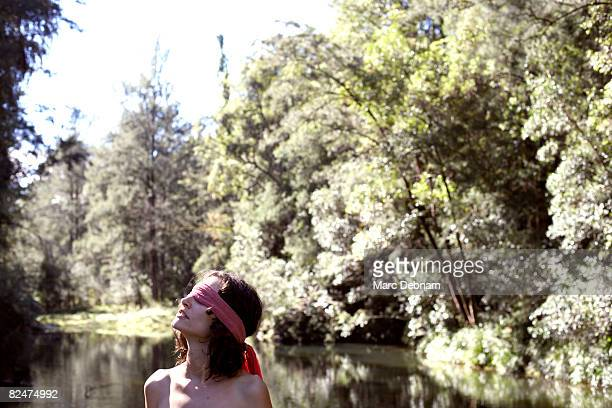 Woman blindfolded in nature