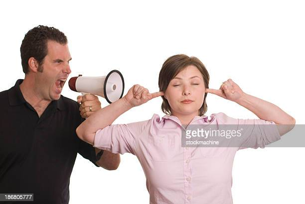 Woman blocking ears to man's yelling