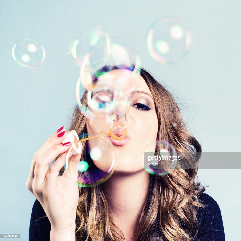 Woman Blow Bubbles : Stock Photo