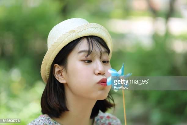 woman blowing a windmill