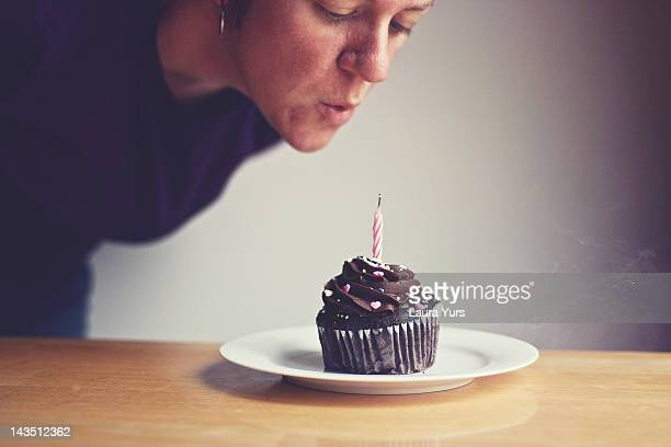 Woman blowing candle