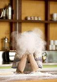 Woman blowing flour