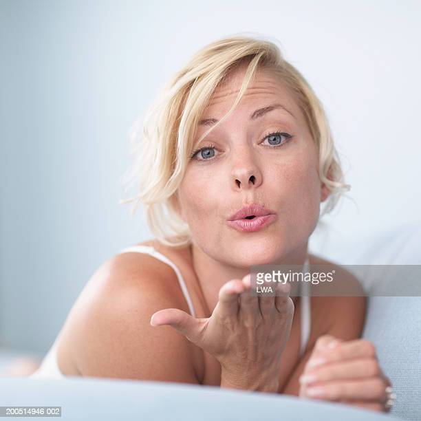 Woman blowing kiss, portrait