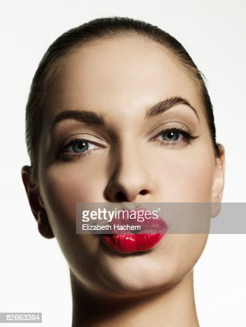 Woman blowing kiss towards camera : Stock Photo