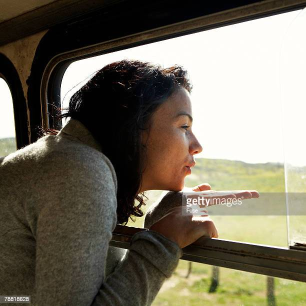 Woman Blowing Kisses out of Bus Window