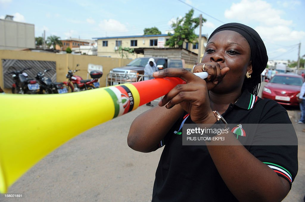 A woman blows plastic horn, popularly known as vuvuzela, as supporters celebrate Ghanian President John Dramani Mahama's imminent victory as Ghana's presidential and parliamentary elections conclude on December 9, 2012 in Accra. Supporters of the candidate of the ruling National Democratic Congress and incumbent President John Mahama started jubilating ahead of the final results announcement by the Election Commission. Mahama held a slight edge over his main rival as vote counting wrapped up on December 9 after high-stakes presidential polls in the emerging west African country, local media said.