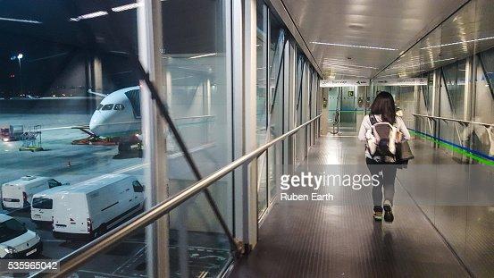 Woman boarding a plane : Stock Photo