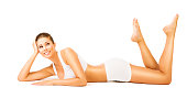 Woman Body Beauty, Girl in White Cotton Underwear, Young Smiling Model Lying on Stomach, isolated on white background