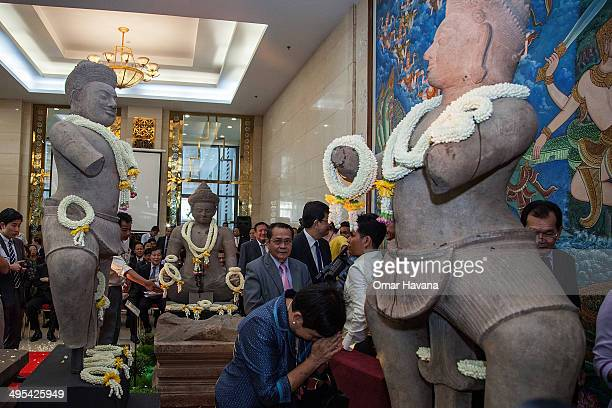 A woman bows in front of the Bhima statue returned to Cambodia by the Norton Simon Museum in the United States during a handover ceremony at the...